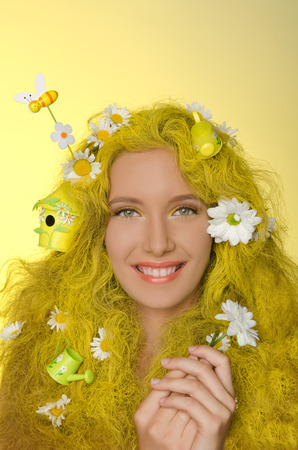 pleasantness: Portrait of young woman with yellow hair, flowers, and bees in them