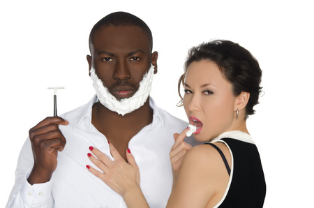 the cheeks: asian woman licking the foam from his cheeks dark-skinned man with razor isolated on white