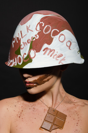 camouflage woman: Beautiful woman with chocolate helmet, camouflage and counter looks away