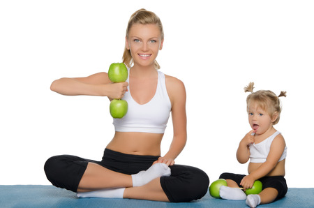 Mother with daughter train weights of green apples photo