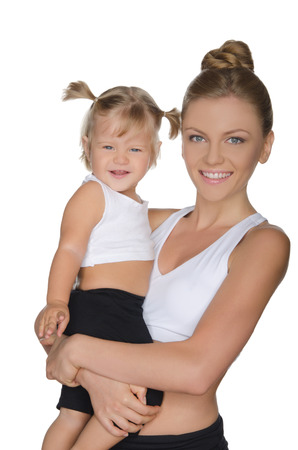Smiling mother with her daughter in clothes for fitness isolated on white Stock Photo