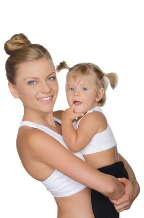 pleasantness: Smiling mother with her daughter in clothes for sport isolated on white