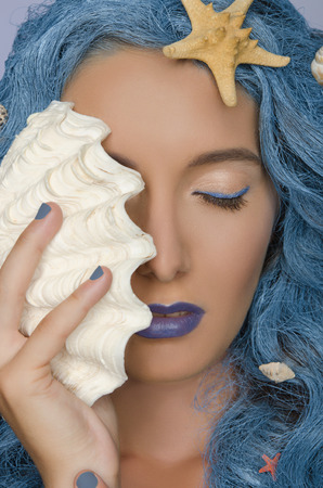 frizz: Portrait of beautiful woman with blue hair, shells and closed eyes