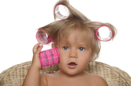 hair curlers: Little beautiful girl with hair curlers isolated on white Stock Photo