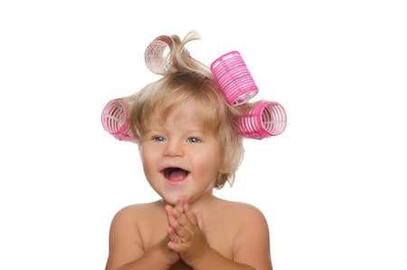 hair curlers: little laughing girl with hair curlers isolated on white