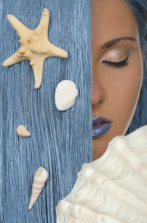 adult mermaid: young woman with straight blue hair, shells, closed eyes