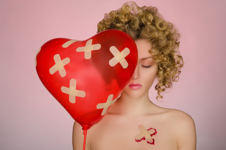 disillusionment: Beautiful woman with patches on the body and a balloon