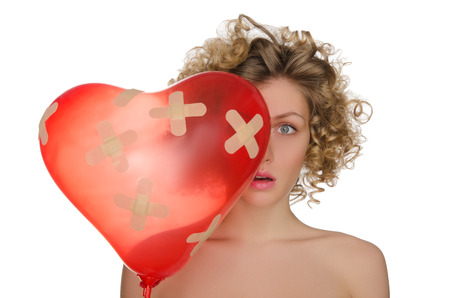 Balloon in shape of heart and upset woman isolated on white Stock Photo
