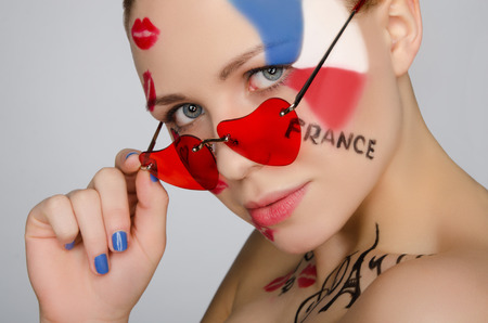 headshot: Portrait woman with glasses on subject of France isolated on white