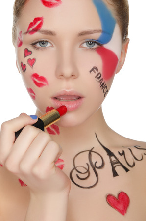 stage makeup: Beautiful woman with makeup on theme of Paris isolated on white