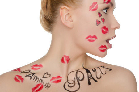 stage makeup: surprised woman with face art on theme of France isolated on white Stock Photo
