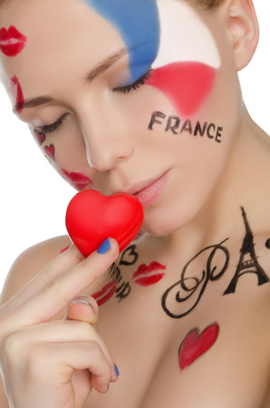 stage makeup: happy woman with make-up on topic of France isolated on white Stock Photo