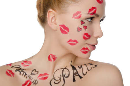 stage makeup: young woman with face art on theme of France isolated on white