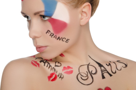 stage makeup: beautiful woman with face art on theme of France isolated on white Stock Photo
