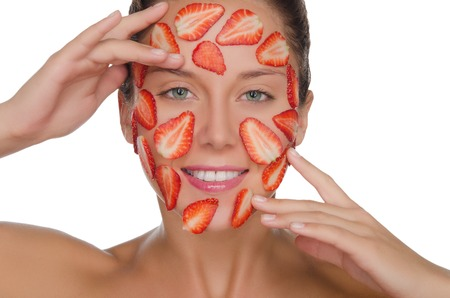 pleasantness: happy woman with mask of strawberries isolated on white