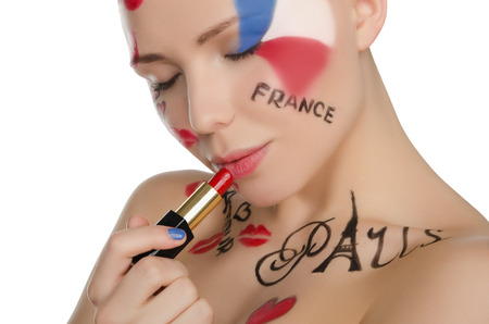 stage makeup: young woman with makeup on theme of Paris isolated on white