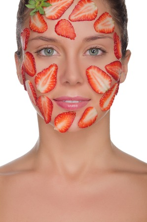 pleasantness: charmingwoman with mask of strawberries isolated on white