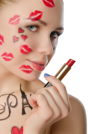 stage makeup: charming woman with face art on theme of Paris isolated on white