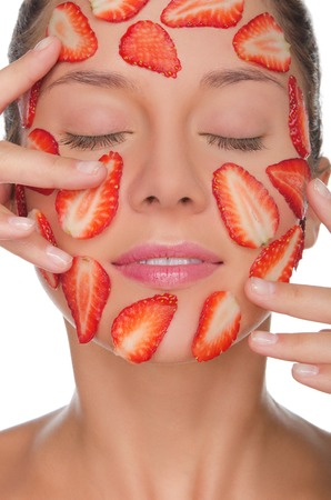 pleasantness: Beautiful woman with mask of strawberries isolated on white