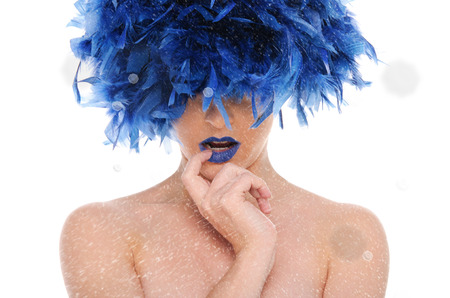 beautiful woman in red wig, with snow on blue background photo