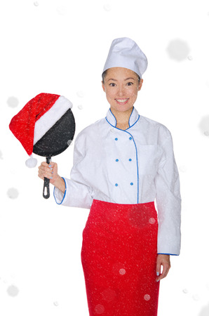 pan asian: Asian chef with frying pan and Christmas hat in falling snow