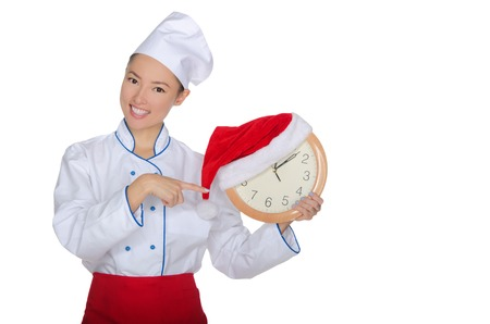 emote: Asian chef points at clock with Christmas hat isolated in white