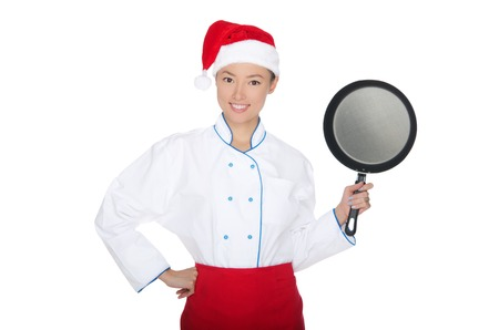 pan asian: smiling asian chef with frying pan and Christmas hat isolated in white