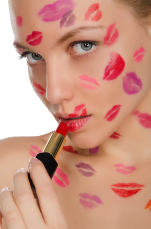 nude sexy woman: Beautiful woman with kisses on face in lipstick and lips isolated on white