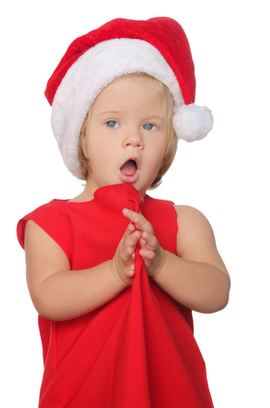 suddenness: surprised girl in christmas cap isolated on white Stock Photo