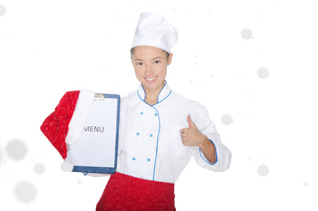 signify: smiling asian chef with christmas menu and cap in snow isolated on white