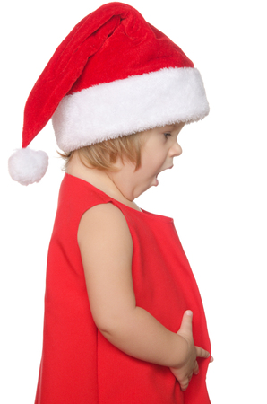 unexpectedness: surprised child in christmas cap isolated on white