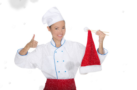 emote: contented asian chef in christmas cap with chopsticks under snow isolated on white