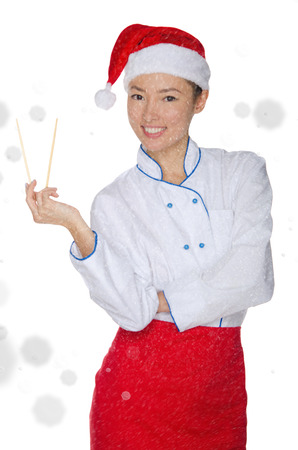 pleasantness: Happy asian chef in christmas outfit with chopsticks under snow isolated on white