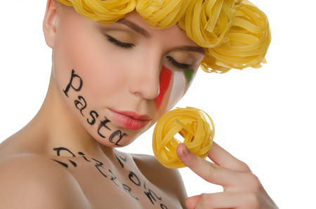 frizz: woman with hair pasta and symbols of Italy isolated on white Stock Photo