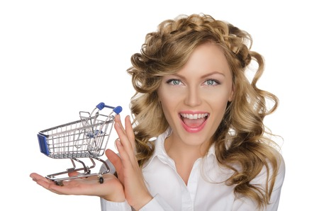 emote: smiling woman with trolley for shopping isolated on white Stock Photo