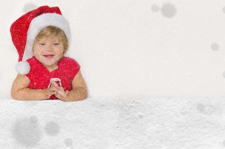 santa suit: Happy european girl in Santa suit with snow studio shot Stock Photo