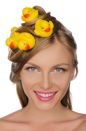 pleasantness: beautiful woman with yellow ducks in her hair isolated on white