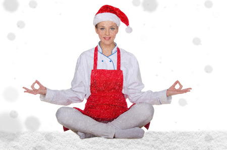 chef in hat of Santa Claus with snow on white background