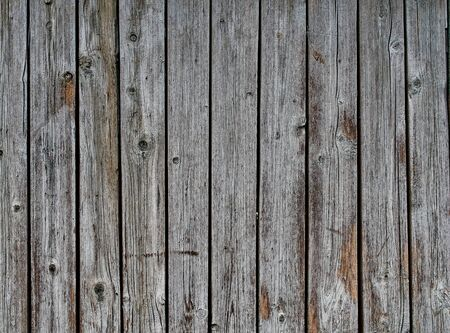 Abstract dark rustic wood texture pattern pale dark gray brown weathered background.