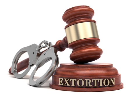 Extortion text on sound block & gavel