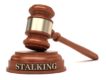 Stalking text on sound block & gavel Stock Photo