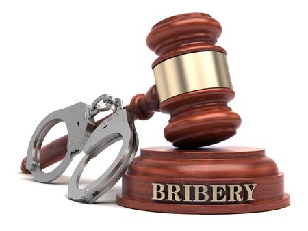 Bribery text on sound block & gavel Stock Photo