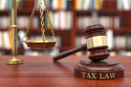 Tax Law. Gavel and word Tax on sound block