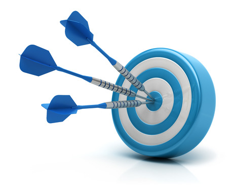 Success concept, darts hitting bullseye on dartboard 写真素材