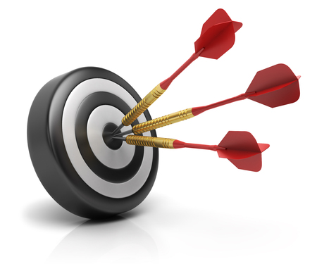 Success concept, darts arrows hitting bullseye on dartboard