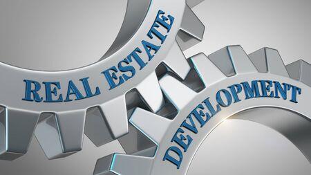 Real estate development written on gear wheel Stockfoto
