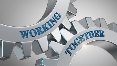 Working together written on gear wheel Stock Photo