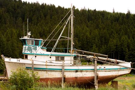 ship wreck: Old wooden boat in an Alaskan Ship yard