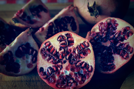 homestyle: Picture of pomegranate, with a home style background Stock Photo