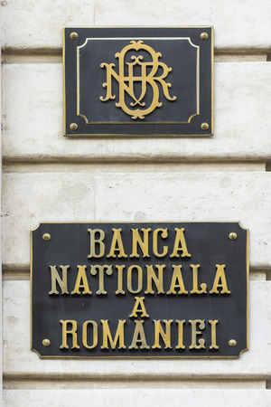 central bank: BUCHAREST, ROMANIA - FEBRUARY 06, 2016: The National Bank Of Romania sign. The NBR is the central bank of Romania and was established in April 1880. It is located in the city of Bucharest.